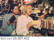 Купить «Ordinary female customers choosing chocolate», фото № 29307432, снято 15 ноября 2018 г. (c) Яков Филимонов / Фотобанк Лори