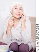 Купить «Woman massaging face», фото № 29307524, снято 21 марта 2017 г. (c) Яков Филимонов / Фотобанк Лори