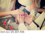 Купить «Woman having manicure in salon», фото № 29307556, снято 2 ноября 2016 г. (c) Яков Филимонов / Фотобанк Лори