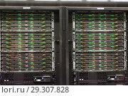 Купить «Closeup of server rack in Supercomputing Center, Barcelona», фото № 29307828, снято 16 января 2018 г. (c) Яков Филимонов / Фотобанк Лори