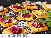 Купить «close-up of portions of Polenta Squares», фото № 29308892, снято 24 октября 2018 г. (c) Oksana Zh / Фотобанк Лори