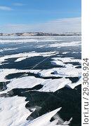 Купить «Winter landscape with snow on ice on the frozen Lake Baikal in cold February day», фото № 29308924, снято 11 февраля 2018 г. (c) Виктория Катьянова / Фотобанк Лори
