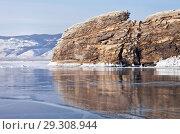 Купить «Baikal Lake in February. The rocky island of Ogoy is reflected in the mirror smooth blue ice», фото № 29308944, снято 11 февраля 2018 г. (c) Виктория Катьянова / Фотобанк Лори