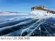 Купить «Lake Baikal in winter. Blue smooth ice with cracks near the beautiful iced Cape Kobyliya Golova is a natural landmark of Olkhon Island», фото № 29308948, снято 23 февраля 2013 г. (c) Виктория Катьянова / Фотобанк Лори
