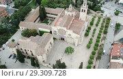 Купить «View from drone of ancient Benedictine abbey in Sant Cugat del Valles, Catalonia, Spain», видеоролик № 29309728, снято 11 июня 2018 г. (c) Яков Филимонов / Фотобанк Лори