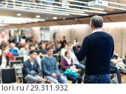 Купить «Sturtup expert giving talk at business event workshop.», фото № 29311932, снято 16 ноября 2018 г. (c) Matej Kastelic / Фотобанк Лори