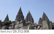 Купить «Candi Prambanan or Candi Rara Jonggrang is an 9th-century Hindu temple compound in Central Java, Indonesia», видеоролик № 29312008, снято 11 октября 2008 г. (c) Куликов Константин / Фотобанк Лори