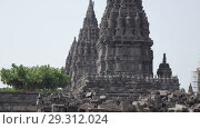 Купить «Candi Prambanan or Candi Rara Jonggrang is an 9th-century Hindu temple compound in Central Java, Indonesia», видеоролик № 29312024, снято 11 октября 2008 г. (c) Куликов Константин / Фотобанк Лори