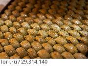 Honey baklava on a baking sheet, Turkish sweets. Стоковое фото, фотограф Юлия Кузнецова / Фотобанк Лори