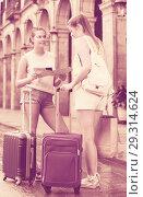 Купить «Positive females tourists using paper map on journey», фото № 29314624, снято 29 мая 2017 г. (c) Яков Филимонов / Фотобанк Лори