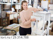 Купить «woman buyer standing near nightstand», фото № 29314788, снято 15 ноября 2017 г. (c) Яков Филимонов / Фотобанк Лори