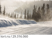 Купить «Snowy winter road during blizzard in Russia. Heavy snow storm.», фото № 29316060, снято 13 декабря 2018 г. (c) Владимир Пойлов / Фотобанк Лори
