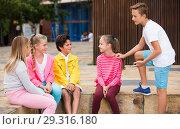 Купить «Company of children are communicating on walk», фото № 29316180, снято 22 июля 2019 г. (c) Яков Филимонов / Фотобанк Лори