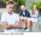 Купить «Sad boy having problems with friends», фото № 29316380, снято 27 июля 2017 г. (c) Яков Филимонов / Фотобанк Лори