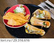 Купить «Guacamole with nachos and tacos», фото № 29316616, снято 19 марта 2019 г. (c) Яков Филимонов / Фотобанк Лори