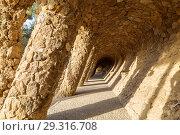 Купить «Walking alley in Park Guell in Barcelona, Catalonia, Spain», фото № 29316708, снято 6 апреля 2018 г. (c) Наталья Волкова / Фотобанк Лори