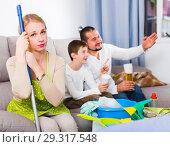 Купить «Upset woman with cleaning equipment», фото № 29317548, снято 12 ноября 2017 г. (c) Яков Филимонов / Фотобанк Лори