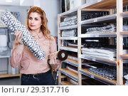 Купить «Young woman choosing bath mat in household shop», фото № 29317716, снято 15 января 2018 г. (c) Яков Филимонов / Фотобанк Лори