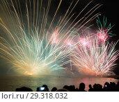 Купить «Bright firework show over water in dark sky», фото № 29318032, снято 22 июля 2017 г. (c) Яков Филимонов / Фотобанк Лори