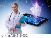 Купить «Woman doctor in telemedicine concept», фото № 29319032, снято 16 июня 2019 г. (c) Elnur / Фотобанк Лори