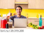 Купить «Young man in healthy eating concept», фото № 29319200, снято 19 июня 2018 г. (c) Elnur / Фотобанк Лори