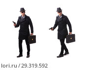 Купить «Man spy with handgun isolated on white background», фото № 29319592, снято 6 ноября 2017 г. (c) Elnur / Фотобанк Лори