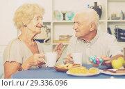 Купить «Smiling elderly spouses enjoying tea with sweets», фото № 29336096, снято 28 августа 2017 г. (c) Яков Филимонов / Фотобанк Лори