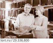 Купить «Man and woman 49-54 years old are choosing consumer electronics», фото № 29336800, снято 27 марта 2019 г. (c) Яков Филимонов / Фотобанк Лори