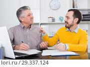 Купить «Mature man and agent sign rental agreement», фото № 29337124, снято 22 января 2019 г. (c) Яков Филимонов / Фотобанк Лори