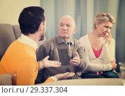 Купить «Parents arguing with son», фото № 29337304, снято 15 ноября 2018 г. (c) Яков Филимонов / Фотобанк Лори