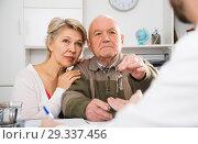 Купить «Old man and woman sign sale agreement», фото № 29337456, снято 22 января 2019 г. (c) Яков Филимонов / Фотобанк Лори