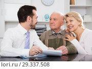 Купить «Woman and eldery man with bank employee», фото № 29337508, снято 15 июля 2019 г. (c) Яков Филимонов / Фотобанк Лори