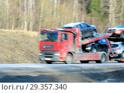 Delivery track car transporter speeding on a highway. Стоковое фото, фотограф Ivan Vdovin / age Fotostock / Фотобанк Лори