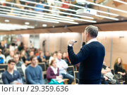 Купить «Sturtup expert giving talk at business event workshop.», фото № 29359636, снято 10 декабря 2018 г. (c) Matej Kastelic / Фотобанк Лори