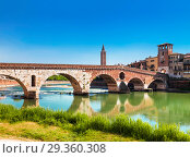 Ponte Pietra is a Roman arch bridge over the Adige river in the Italian city of Verona. Italy (2017 год). Стоковое фото, фотограф Наталья Волкова / Фотобанк Лори