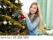 Купить «Cheerful blond girl with globes near Xmas tree», фото № 29366580, снято 20 июня 2019 г. (c) Яков Филимонов / Фотобанк Лори