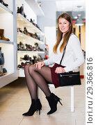 Купить «Cheerful woman is posing with handbag and modern shoes», фото № 29366816, снято 13 декабря 2017 г. (c) Яков Филимонов / Фотобанк Лори