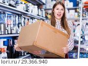 Купить «Girl holding box with purchase», фото № 29366940, снято 12 декабря 2017 г. (c) Яков Филимонов / Фотобанк Лори