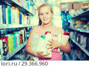 Купить «Cheerful girl holding shampoo and shower gel», фото № 29366960, снято 5 августа 2017 г. (c) Яков Филимонов / Фотобанк Лори