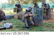 Купить «Team of adult people playing paintball on battlefield outdoor, running with guns», фото № 29367056, снято 22 сентября 2018 г. (c) Яков Филимонов / Фотобанк Лори