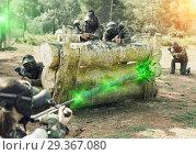 Купить «Portrait of opposing teams in camouflage playing paintball a», фото № 29367080, снято 22 сентября 2018 г. (c) Яков Филимонов / Фотобанк Лори