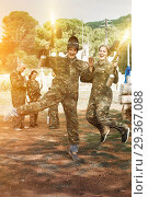 Купить «joyous young man and woman in full paintball gear having fun aft», фото № 29367088, снято 22 сентября 2018 г. (c) Яков Филимонов / Фотобанк Лори
