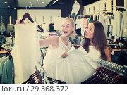 Купить «two women picking new blouse in fashion shop», фото № 29368372, снято 18 декабря 2018 г. (c) Яков Филимонов / Фотобанк Лори