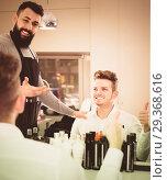 Купить «professional guy stylist demonstrating final haircut to client at hairdressing salon», фото № 29368616, снято 27 января 2017 г. (c) Яков Филимонов / Фотобанк Лори