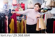 Купить «Woman choosing colorful blouse», фото № 29368664, снято 7 февраля 2017 г. (c) Яков Филимонов / Фотобанк Лори