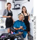 Купить «Hairdressers finished haircut for senior woman», фото № 29368756, снято 26 июня 2018 г. (c) Яков Филимонов / Фотобанк Лори