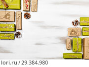 Купить «Christmas composition gift boxes with pine tree and decoration for mock up template design. View from above. copy space», фото № 29384980, снято 5 ноября 2018 г. (c) Сергей Тимофеев / Фотобанк Лори