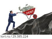 Купить «Businessman pushing wheelbarrow uphill in debt loan concept», фото № 29385224, снято 22 ноября 2018 г. (c) Elnur / Фотобанк Лори