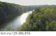 Купить «River and Green Forest nature near summer Cesis city in Latvia, Gauya, 4K drone flight landscape from above», видеоролик № 29386816, снято 5 ноября 2018 г. (c) Aleksejs Bergmanis / Фотобанк Лори