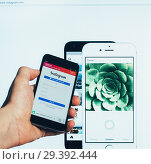 Купить «The registration page on the popular social network for sharing and rating photos and short videos Instagram on the screen of the Xiaomi smartphone and on the computer monitor», фото № 29392444, снято 27 мая 2019 г. (c) Андрей С / Фотобанк Лори